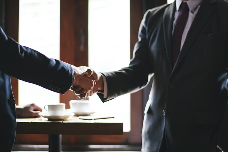 A client and customer doing a handshake
