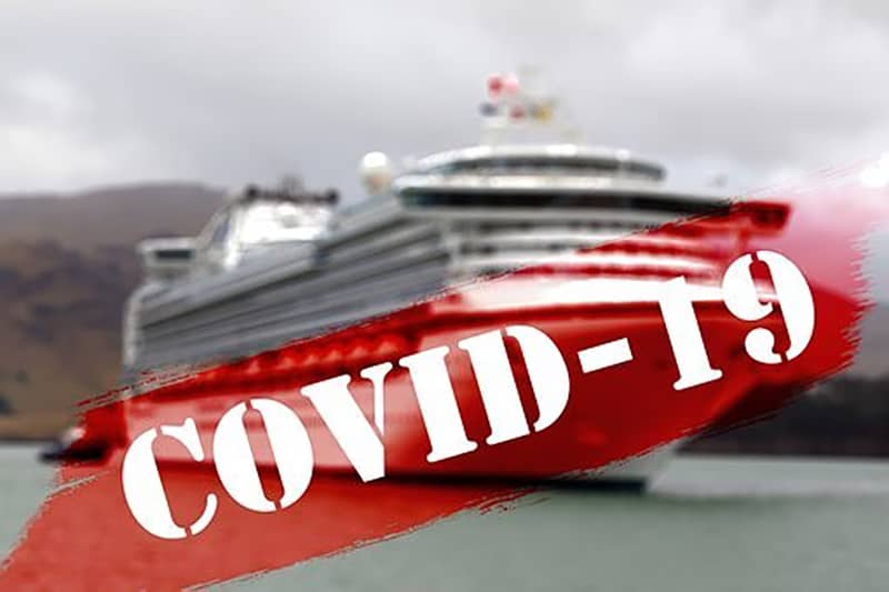 cruise ship out to sea - red covid-19 banner across image