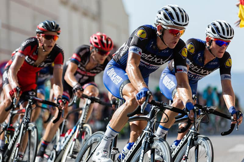 A group of professional cyclists in a race