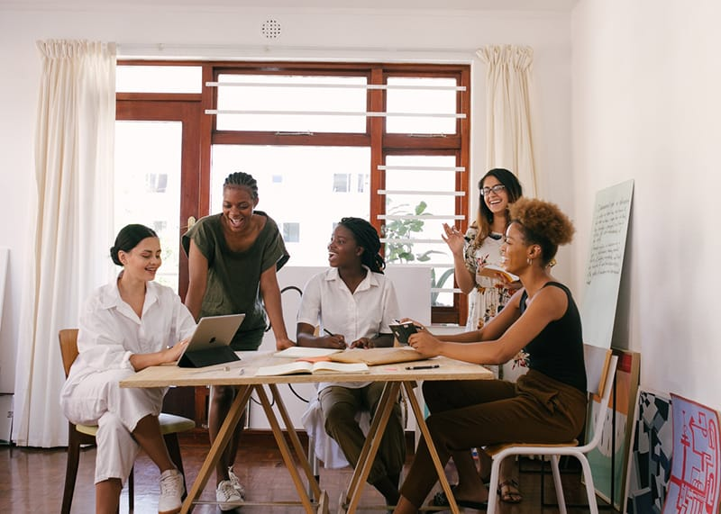 group of women having a meeting in the workplace