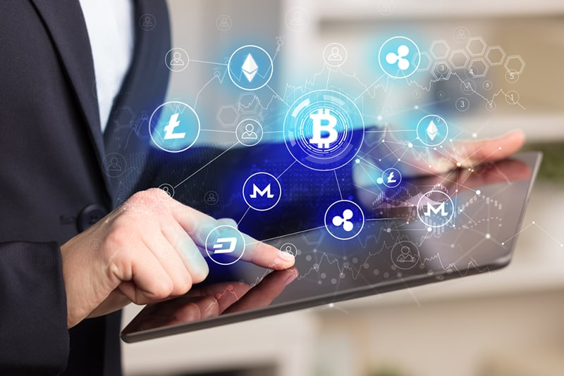 concept person using digital currencies on tablet computer
