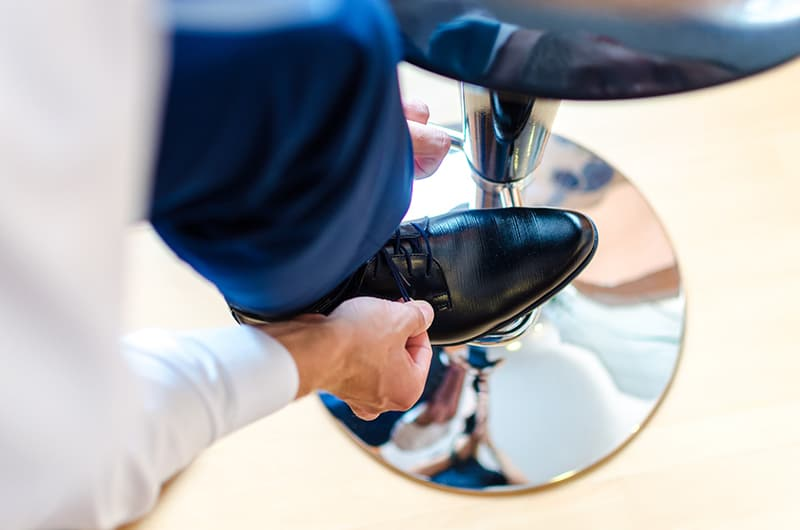 Person lacing up his shoe