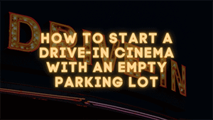 Drive in signage in neon color with black background