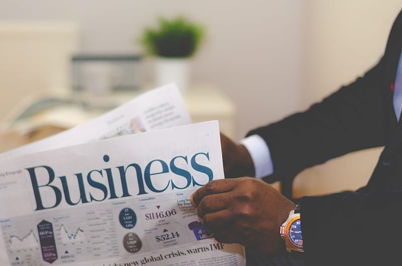 A businessman reading a business newspaper