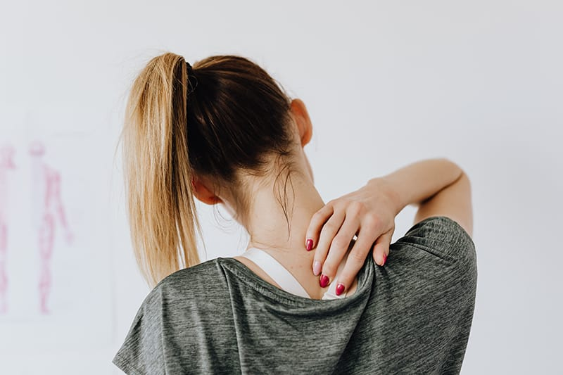 Woman showing pain spot on her back