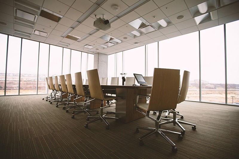 Brown chairs and table in conference room
