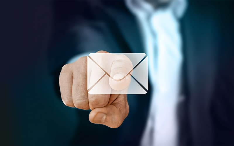 Businessman pointing email icon