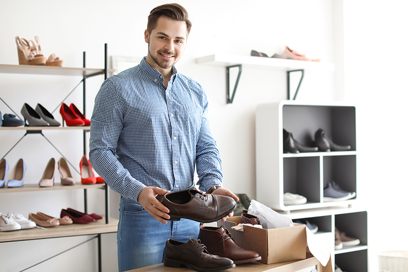 Young man choosing shoes in a store