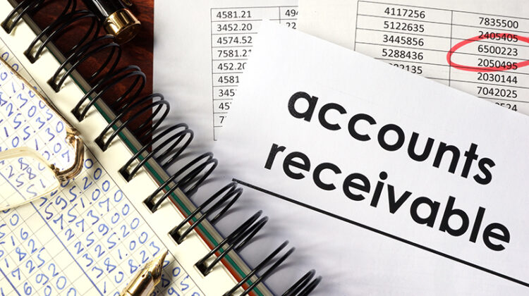 Note pad with figures and paper with account receivable text