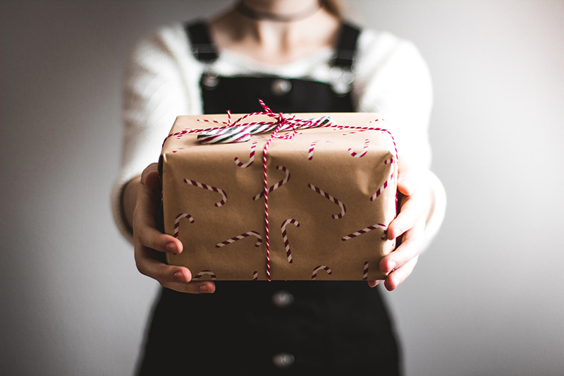 Person holding a gift wrapped box