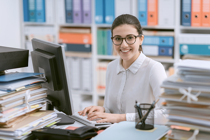 Young happy woman working in an accounting firm