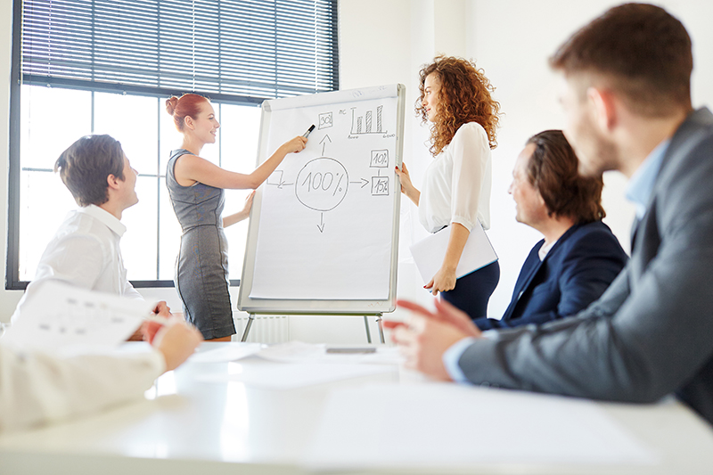 Woman explaining graphs on a business meeting
