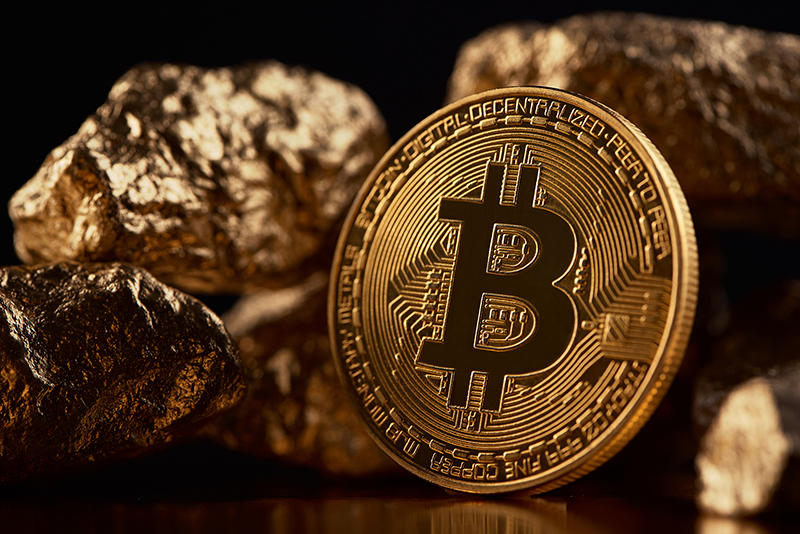Goleden bitcoin on black background and gold lamps