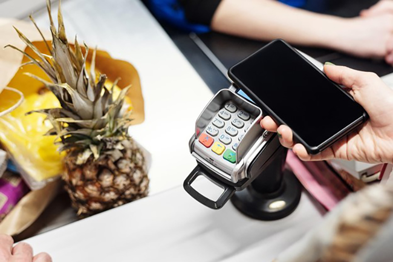 Person paying goods using smartphone