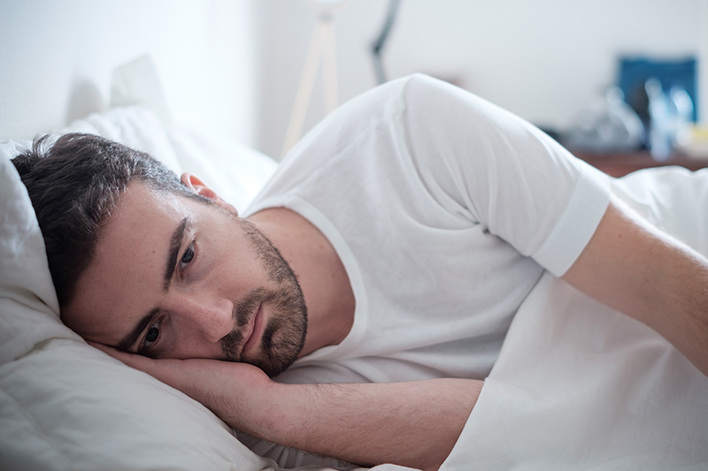 Man lying in the bed