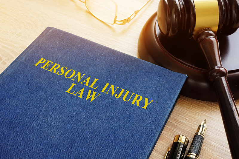 Personal injusry law on desk and gavel