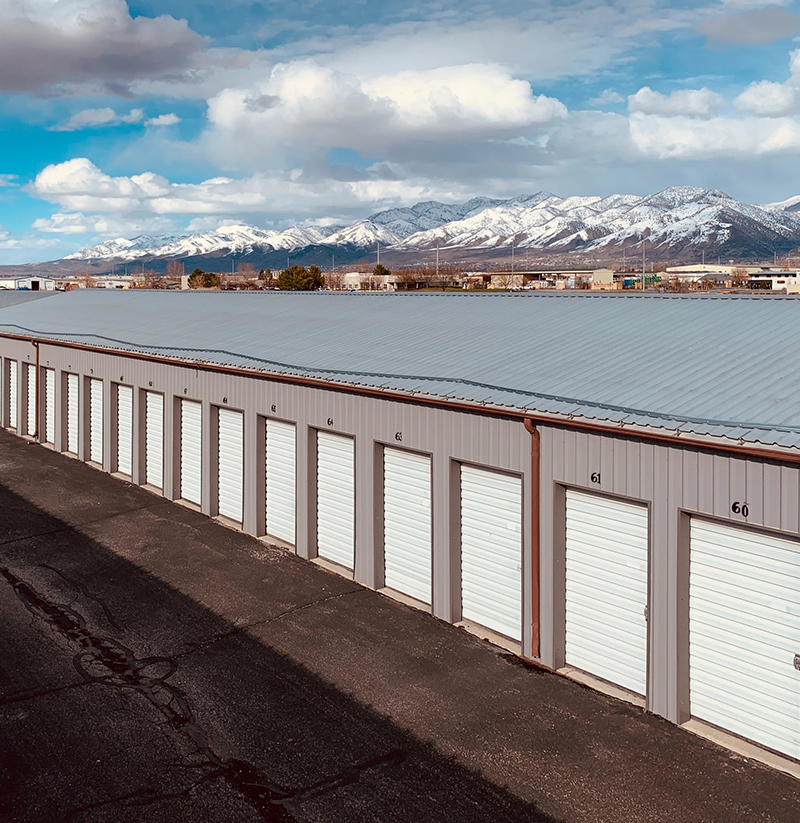 Snowy mountains & self storage in Logan, Utah. TK Secure Storage of Logan & Brigham City surrounded by mountains and panoramic views.