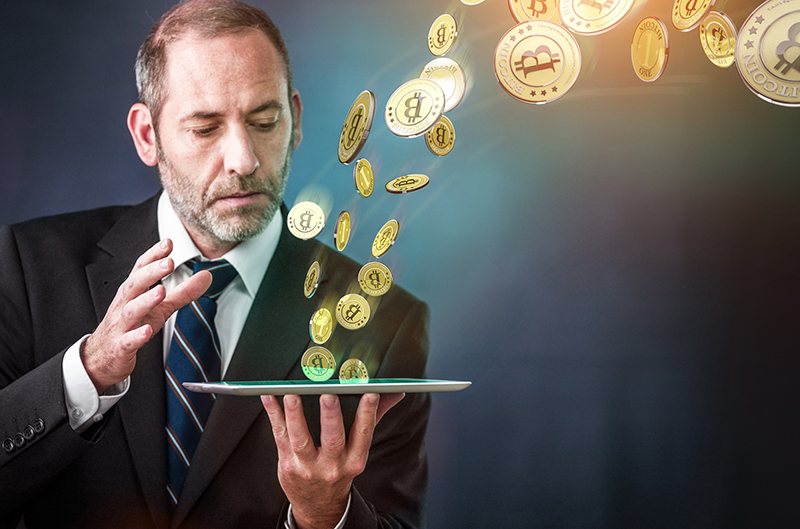 Businessman holding tablet and bitcoin concept
