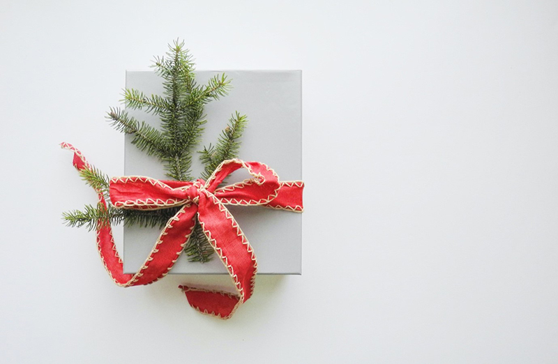 christmas gift wrapped with red ribbon