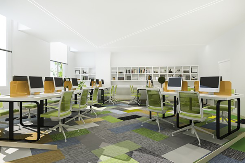 Open plan officce space with desks chairs and computers.