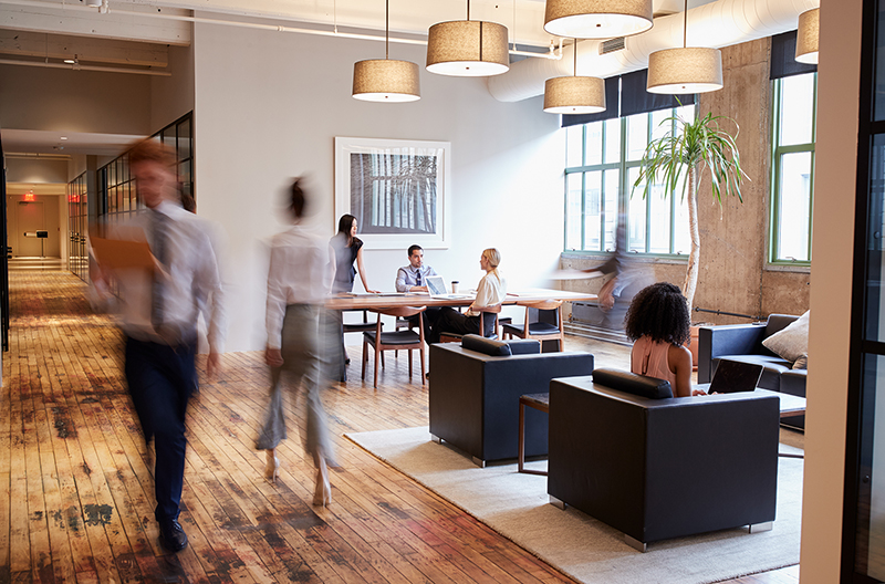 Business people at work in a busy luxury virtual office space