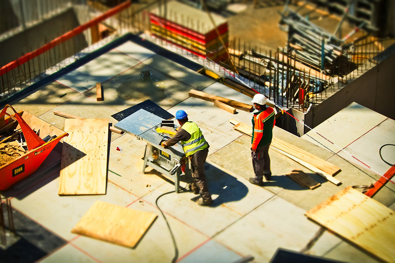 Two man on construction site during daytime