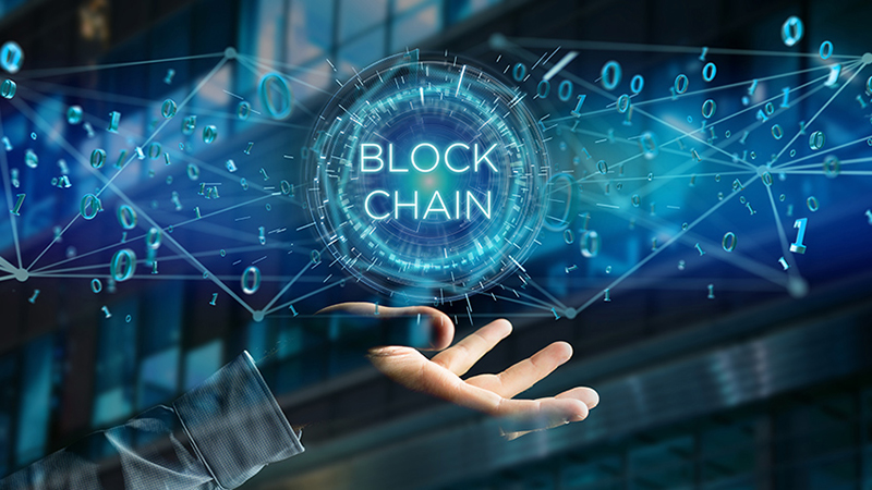 Hand of a person and the blockchain concept