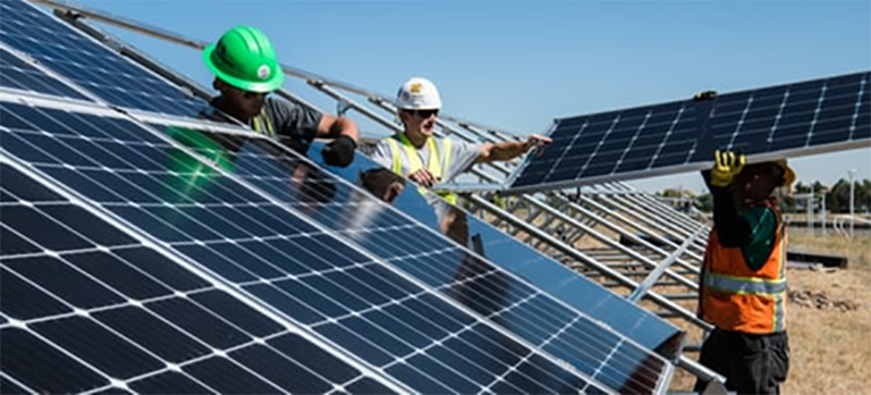 solar panels being fitter to a rooftop