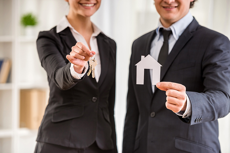 Man and woman real estate agent in black suit