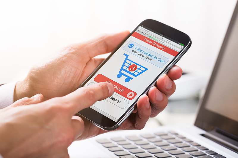 Close-up Of A Businessperson's Hand Clicking On Checkout Option While Shopping On Mobile Phone – ecommerce