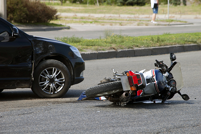 motorcycle and car involved in a collision