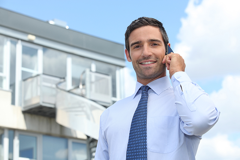 Man wearing a tie calling on his mobile phone