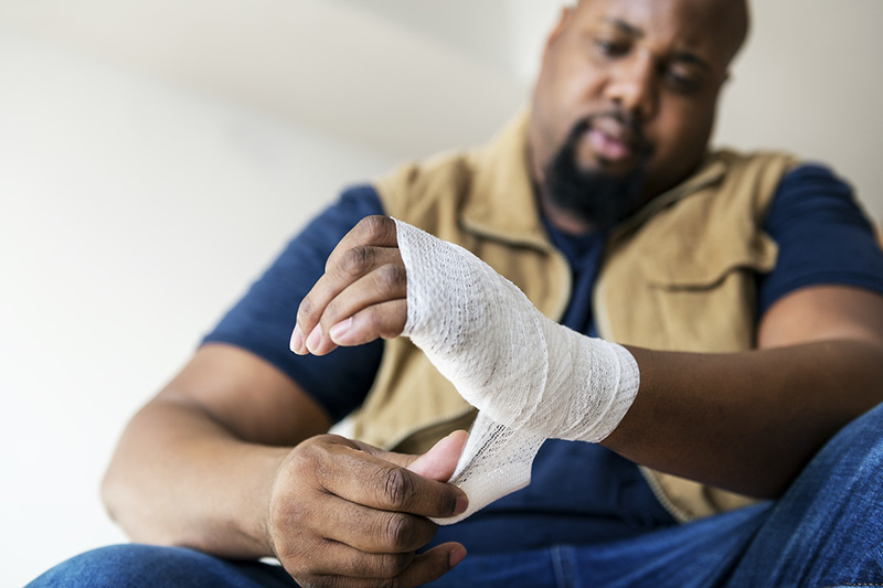 A person involved in work-related accident – bandaged hand and wrist