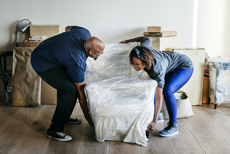Couple moving into a new house – packing and moving