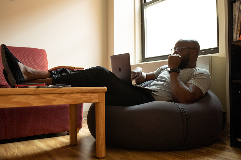 Man using laptop sitting in the couch