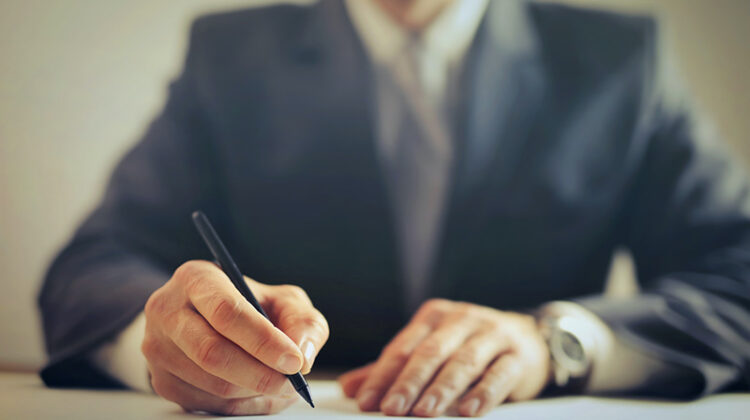 Businessman signing contract in the office