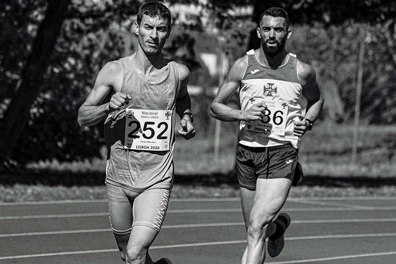 Muscular male athletes running during track and field