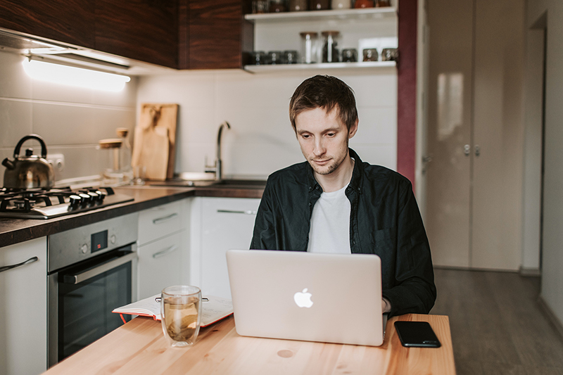 Employee working remotely from kitchen table