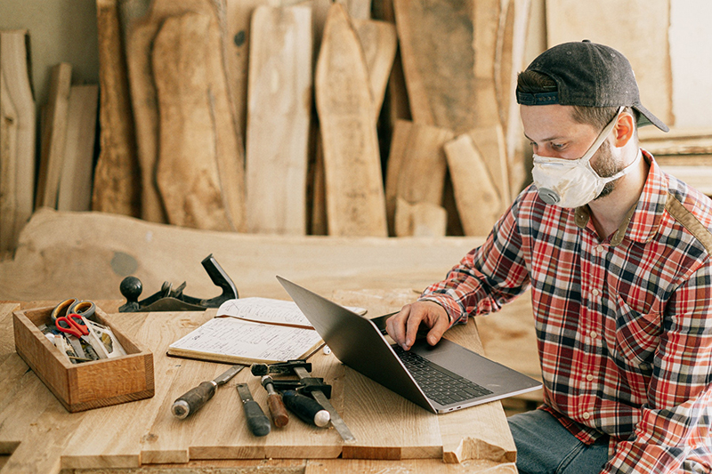 Man using laptop on the top of wooden table