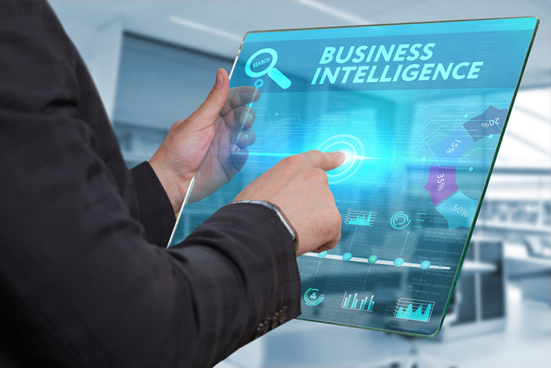 Business, Technology, Internet and network concept. Business man working on the tablet of the future, select on the virtual display: Business intelligence