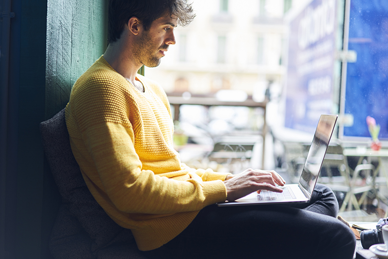 Male freelancer working on his laptop