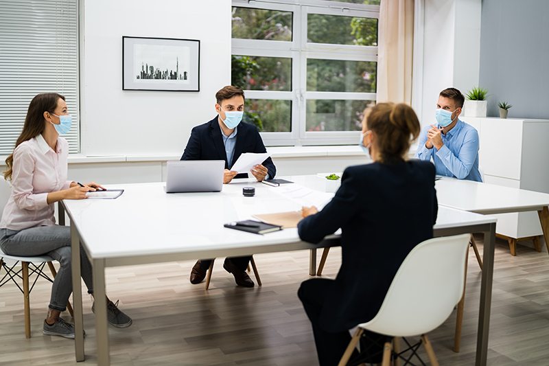 Business Meeting At the Office Wearing Face Mask