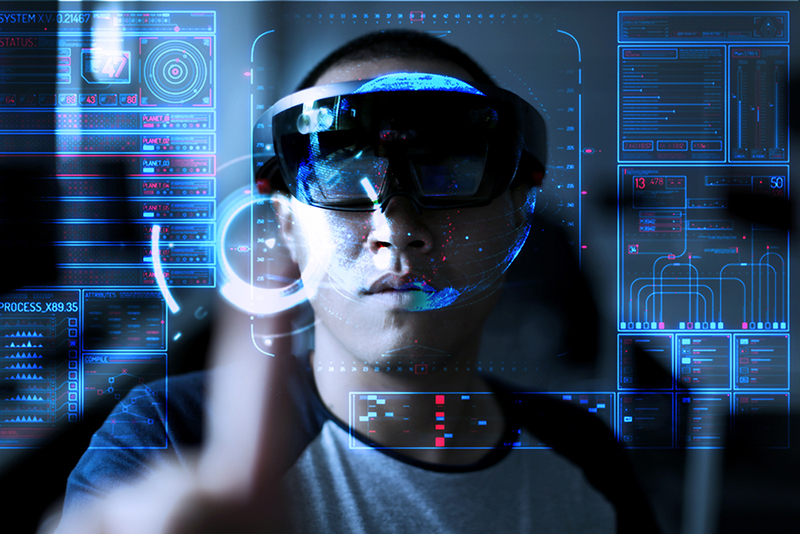 Young  men trying Virtual Reality or augmented reality with HoloLens headset - technology