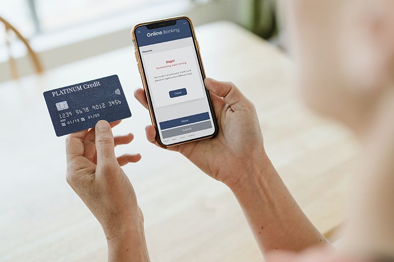 Woman processing her credit card via a mobile phone