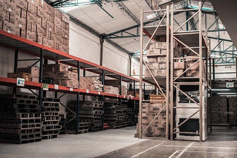 Warehouse with brown boxes on the rack