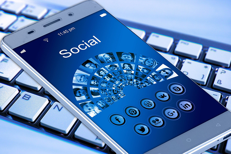 Mobile phone with social media icons on the screen