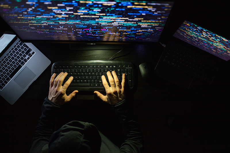 hacker coding at night cybersecurity concept