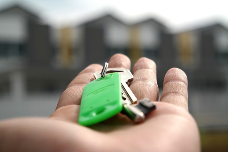open hand with keys place on palm