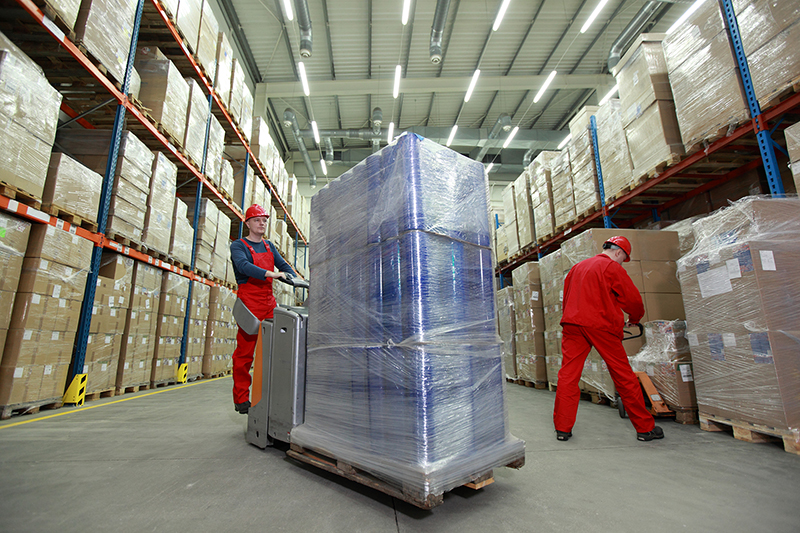 Two man working inside the warehouse