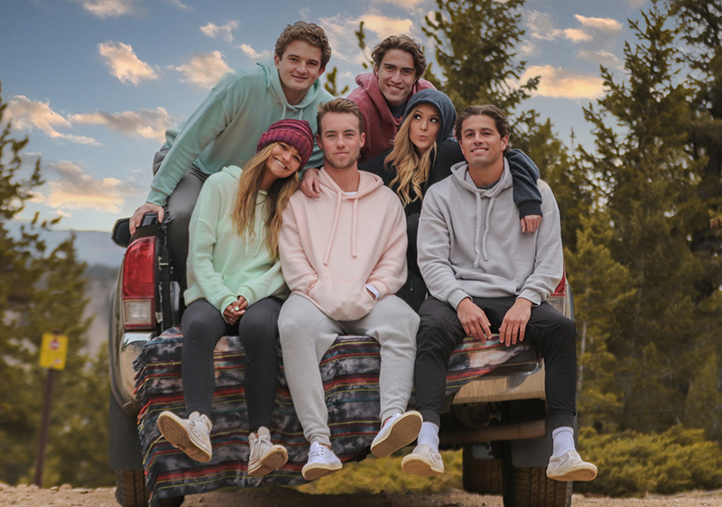 Group of young people wearing hoodies